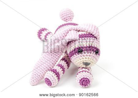 Knitted Pink Rabbit Toy Lays Isolated On White