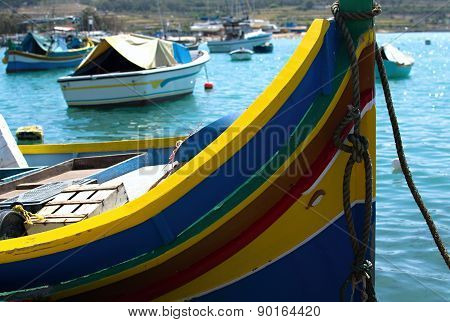 Traditional Luzzu Boats In Marsaxlokk