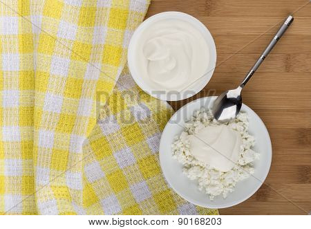 Cottage Cheese And Sour Cream In White Saucer