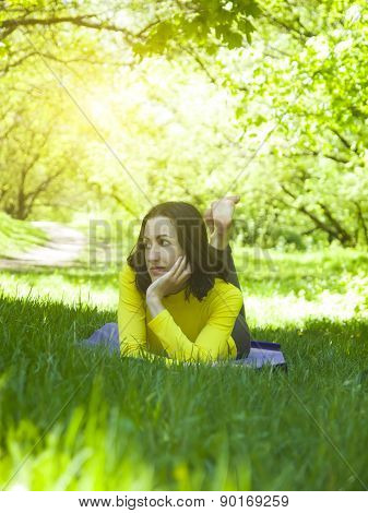 Girl Lying On The Grass.