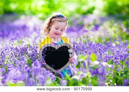 Little Girl In Bluebelss Flowers