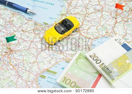 Pen, Money And Yellow Car On Map