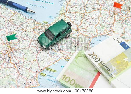 Pen, Notes And Green Car On Map