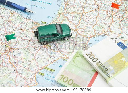 Pen, Money And Green Car On Map