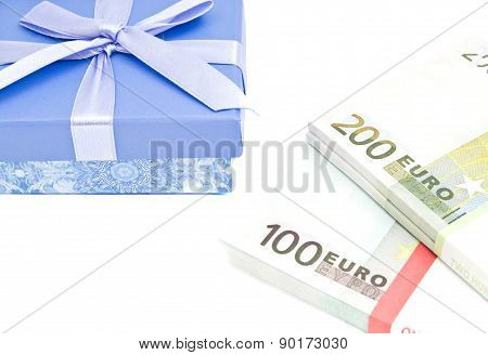 Banknotes And Blue Gift Box