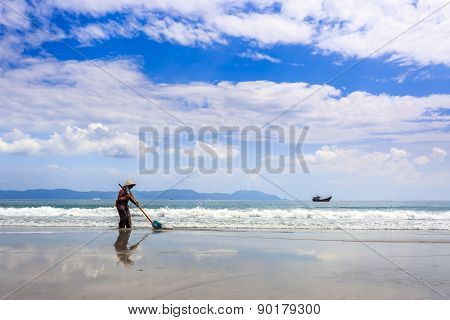 Worker Cleaning Doc Let Beach, Vietnam