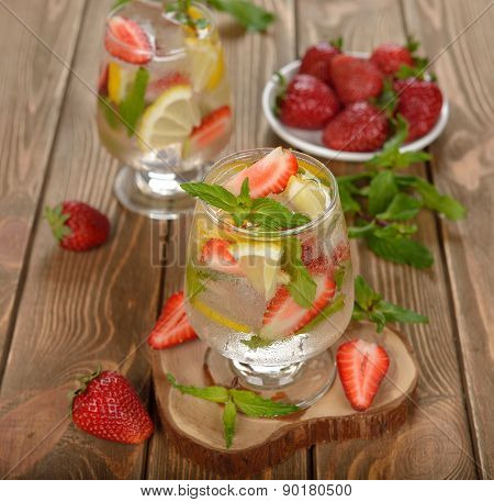 Cold Drink With Strawberries, Lemon And Mint