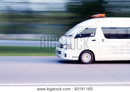 Blurry Ambulance High Speed In Motion Driving On The Road