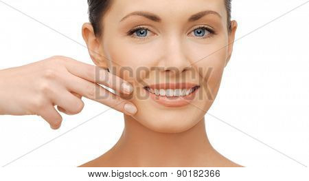 healthcare and beauty concept - beautiful woman touching her face skin