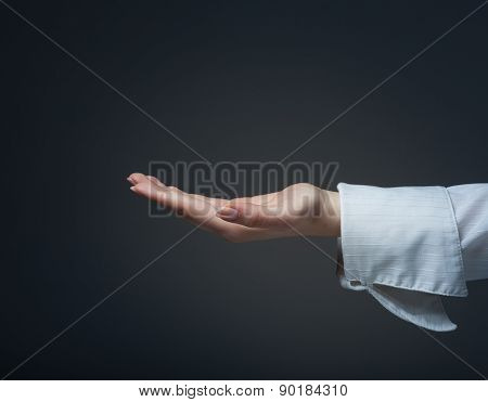 Woman Hand Sign Isolated On A Dark Background
