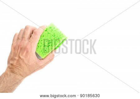 Male Hand Holding Green Cleaning Sponge On White Background