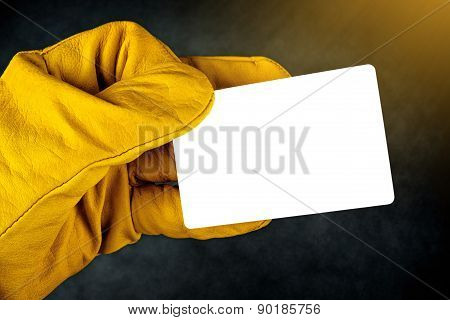 Hand In Leather Construction Working Gloves Holding Blank Busines Card