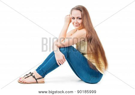 Young female sitting on the floor