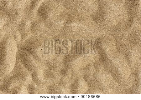 Sand Texture -Closeup of sand pattern of a beach in the summer