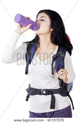 Beautiful Hiker Drinks Fresh Water