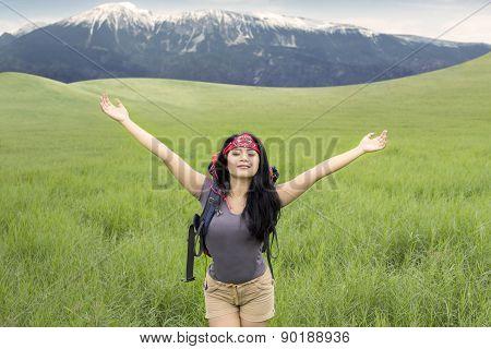 Female Hiker Enjoy Fresh Air On The Hill