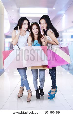 Group Of Teenage Girl Shopping Together