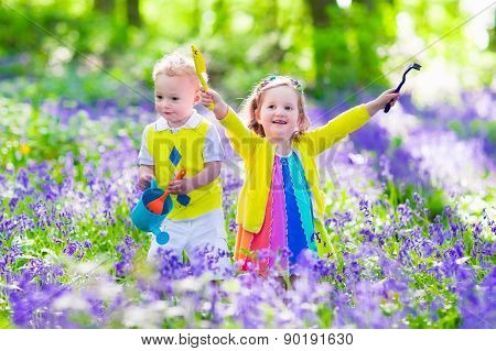 Kids In A Garden With Bluebell Flowers