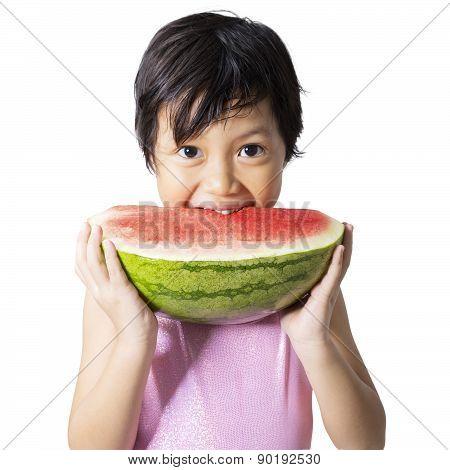Little Child Eats Watermelon In Studio