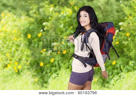 Pretty Woman Doing Trekking In Woods