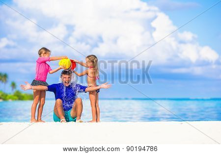 Happy family having fun during summer beach vacation
