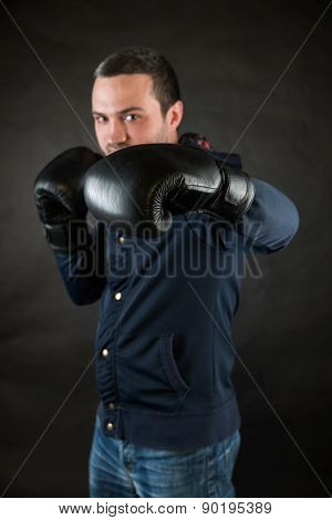 Handsome Man With Black Boxing Gloves. A Concept Of A Challenge.