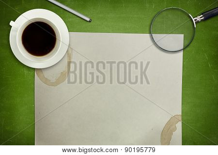 Green blackboard with coffee cup and empty paper sheet