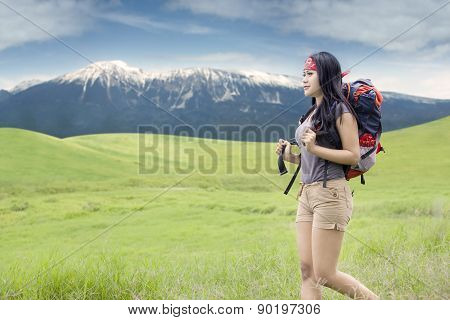 Woman With Rucksack Walking In Nature