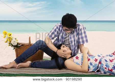Young Man Caress His Girlfriend At Beach