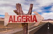 stock photo of algiers  - Algeria wooden sign with desert road background - JPG