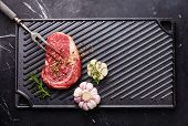 picture of ribeye steak  - Raw fresh Blank Angus Steak Ribeye on cast iron grill surface on marble background - JPG