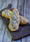 picture of sesame seed  - Braided brown bread with poppy seeds and sesame seeds