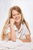 image of early morning  - young woman sitting in bedroom at early morning - JPG