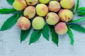 image of peach  - group of fresh peaches on wood background - JPG