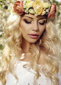 foto of headband  - fashion outdoor photo of beautiful sensual woman with long blond hair and flower - JPG