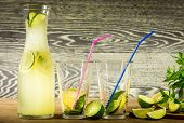 image of refreshing  - Refreshing lemonade drink and ripe fruits against wooden background - JPG