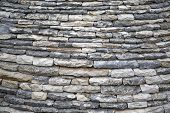 foto of stone house  - Close view of the stones of the roof of a house in Alberobello - JPG