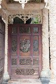 image of carving  - Carved door with carved columns and portico - JPG