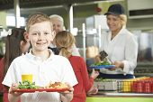 stock photo of school lunch  - Male Pupil With Healthy Lunch In School Cafeteria - JPG
