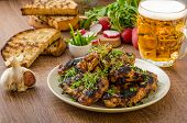image of chive  - Grilled teriyaki chicken wings with chive and microgreens on top garlic toast with fresh herbs and czech beer - JPG