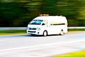 image of ambulance  - blurry Ambulance high speed in motion driving on the road - JPG