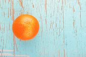 picture of bittersweet  - Fresh Ripe Sweet Orange Fruit on Rustic Grunge Blue Wood Background Top View - JPG