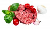 stock photo of patty-cake  - Hand Made From Minced Beef Pork burgers patties with Basil garlic pepper tomato and sliced red pepper - JPG