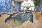 picture of health center  - Large jacuzzi pool in room of luxury health spa center with candles - JPG