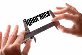 pic of ignore  - Color horizontal shot of two hands holding a caliper and measuring the word  - JPG