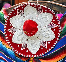 picture of mexican fiesta  - view of Mexican souvenirs colorful mariachi sombrero and poncho - JPG