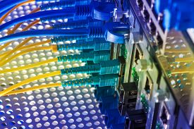 stock photo of cisco  - close up of network cables connected to switch - JPG