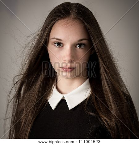 Beautiful Teen Girl With Long Hair And A Big Collar