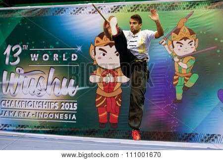 JAKARTA, INDONESIA - NOVEMBER 15, 2015: Costa Torres of Portugal performs the movements in the men's Gunshu (staff) event at the 13th World Wushu Championship 2015 held at Istora Senayan, Jakarta.