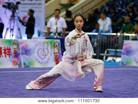 JAKARTA, INDONESIA - NOVEMBER 15, 2015: Vera Tan of Singapore performs the movements in the women's Taijijian event at the 13th World Wushu Championship 2015 held at Istora Senayan, Jakarta.